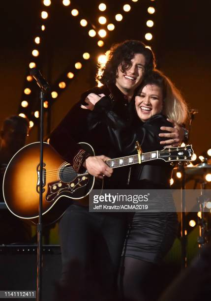 Dan Smyers and Kelly Clarkson onstage during the 54th Academy Of Country Music Awards at MGM Grand Garden Arena on April 07 2019 in Las Vegas Nevada