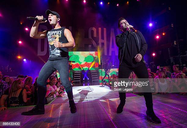 Dan Smyers and Shay Mooney of country music duo Dan Shay perform in support of the Good For a Good Time Tour 2016 at DTE Energy Music Theater on...