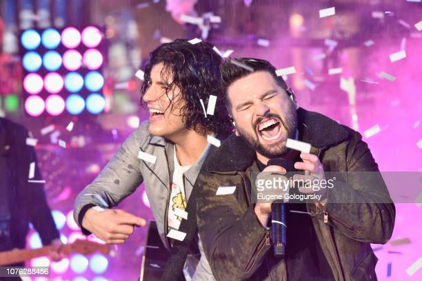 Dan Smyers and Shay Mooney of Dan and Shay perform on stage during Dick Clark's New Year's Rockin' Eve With Ryan Seacrest 2019 on December 31 2018 in...