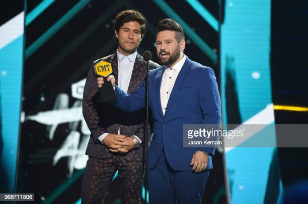 Dan Smyers and Shay Mooney of Dan Shay accept award onstage at 2018 CMT Music Awards at Bridgestone Arena on June 6 2018 in Nashville Tennessee