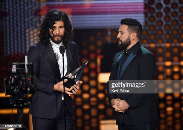Dan Smyers and Shay Mooney of Dan Shay accept the Favorite Song Country award for 'Speechless' onstage during the 2019 American Music Awards at...