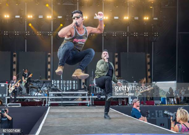 Dan Smyers and Shay Mooney of Dan Shay perform during day 2 of Faster Horses Festival at Michigan International Speedway on July 22 2017 in Brooklyn...