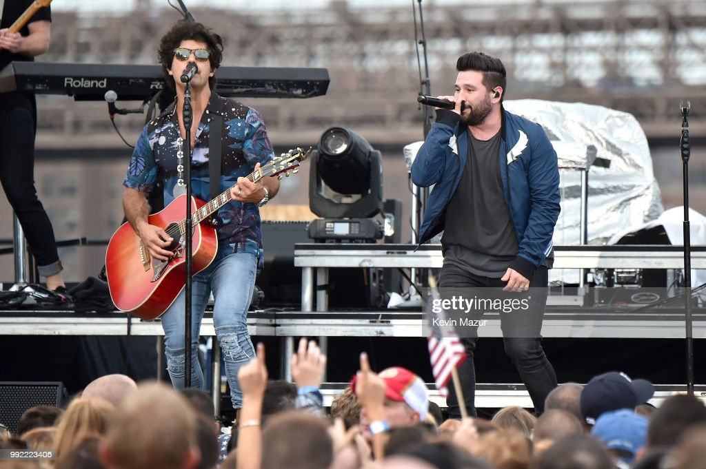 Dan Smyers and Shay Mooney of Dan + Shay perform on stage at the Spotify's Hot Country Live Series with Carrie Underwood, Dan + Shay and Filmore at Pier 17 on July 4, 2018 in New York City.