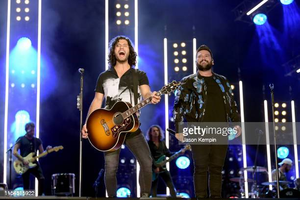 Dan Smyers and Shay Mooney of Dan Shay perform on stage during day 2 for the 2019 CMA Music Festival on June 07 2019 in Nashville Tennessee
