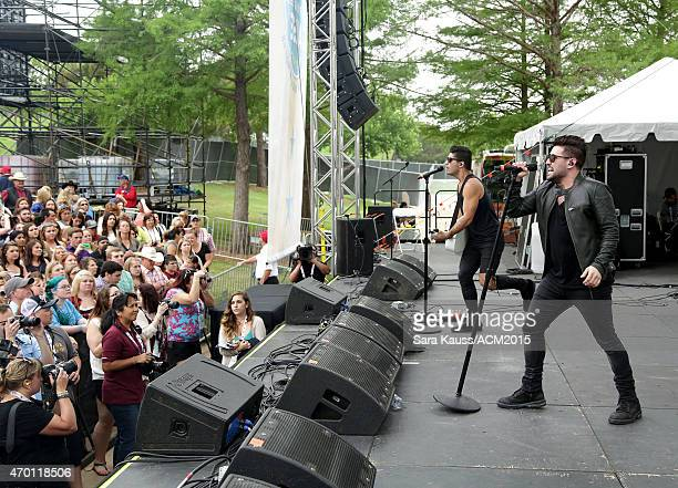 Dan Smyers and Shay Mooney of Dan Shay perform onstage during the ACM Party For A Cause Festival at Globe Life Park in Arlington on April 17 2015 in...