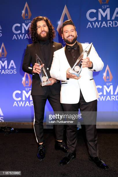 Dan Smyers and Shay Mooney of Dan + Shay pose in the press room of the 53rd annual CMA Awards at the Bridgestone Arena on November 13, 2019 in...