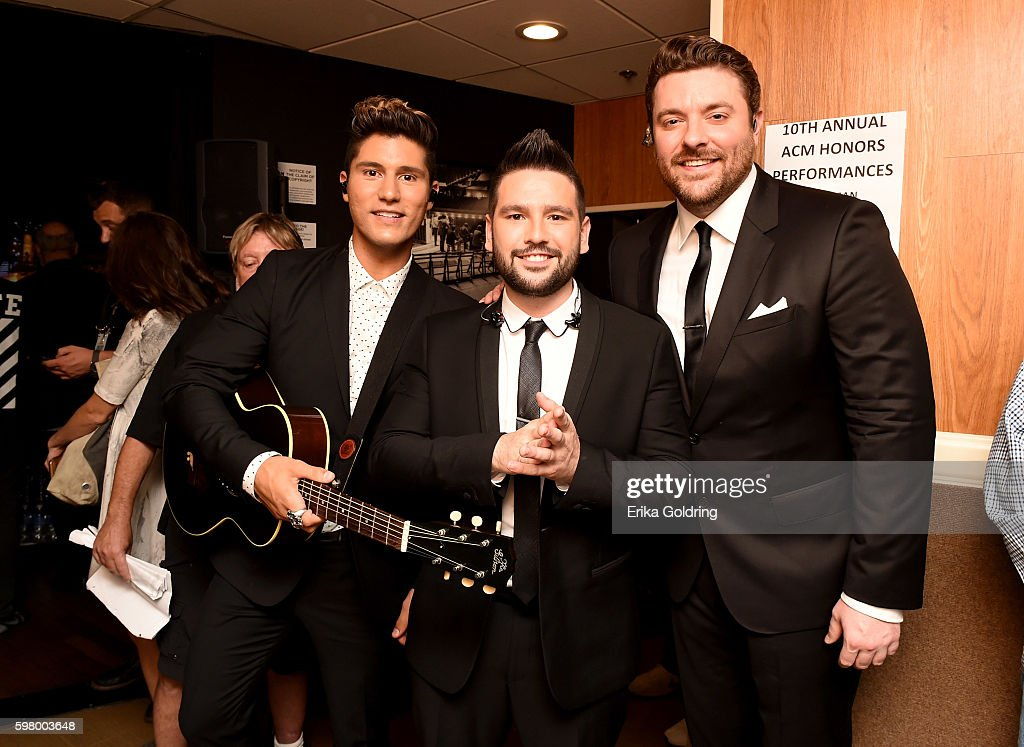 Dan Smyers and Shay Mooney of Dan + Shay pose with Chris Young during the 10th Annual ACM Honors at the Ryman Auditorium on August 30, 2016 in Nashville, Tennessee.