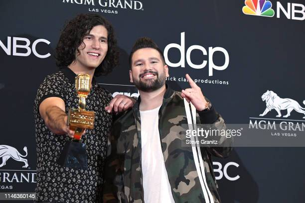 Dan Smyers and Shay Mooney of Dan Shay pose with the award for Top Country Duo/Group in the press room during the 2019 Billboard Music Awards at MGM...