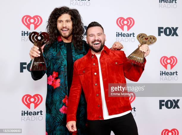 Dan Smyers and Shay Mooney of music group Dan + Shay, winners of the Best Duo/Group of the Year award, attend the 2021 iHeartRadio Music Awards at...