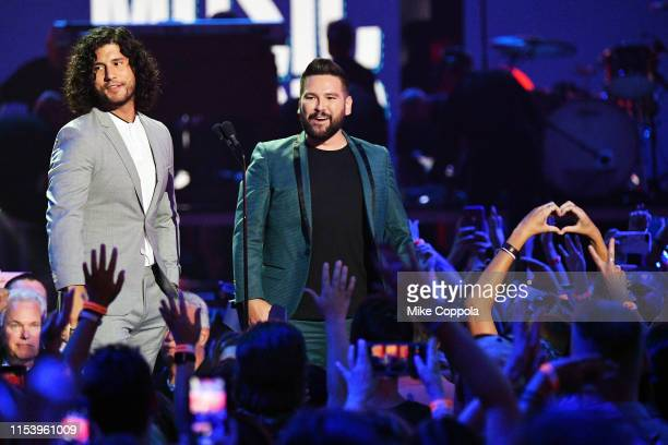 Dan Smyers and Shay Mooney of musical duo Dan Shay accept an award at the 2019 CMT Music Awards at Bridgestone Arena on June 05 2019 in Nashville...