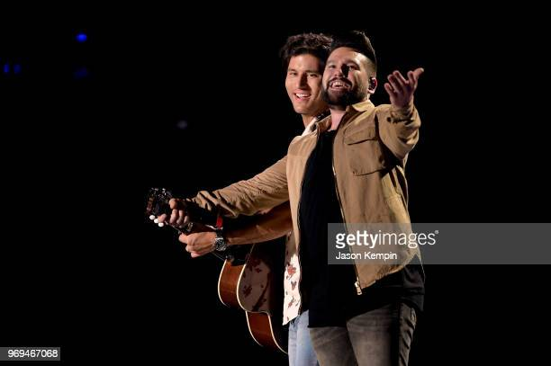 Dan Smyers and Shay Mooney of musical duo Dan Shay perform onstage during the 2018 CMA Music festival at the Nissan Stadium on June 7 2018 in...