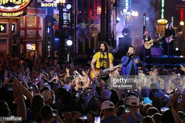 Dan Smyers and Shay Mooney of musical group Dan Shay perform at the 2019 CMT Music Awards at Bridgestone Arena on June 05 2019 in Nashville Tennessee