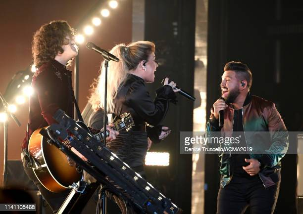 Dan Smyers Kelly Clarkson and Shay Mooney perform onstage during the 54th Academy Of Country Music Awards at MGM Grand Garden Arena on April 07 2019...