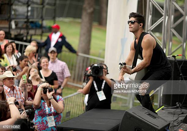 Dan Smyers of Dan Shay performs onstage during the ACM Party For A Cause Festival at Globe Life Park in Arlington on April 17 2015 in Arlington Texas