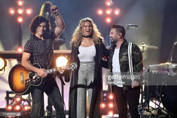 Dan Smyers of Dan Shay Tori Kelly and Shay Mooney of Dan Shay perform onstage during the 2019 Billboard Music Awards at MGM Grand Garden Arena on May...