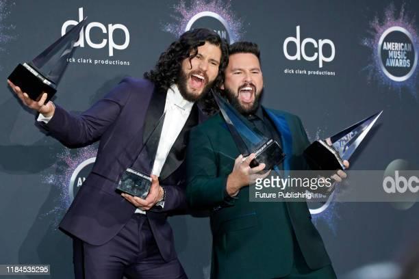 STATES NOVEMBER 24 2019 Dan Smyers Shay Mooney Dan Shay in the press room at the 2019 American Music Awards at Microsoft Theater PHOTOGRAPH BY P...