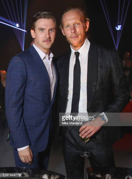 Dan Stevens and Laurence Fox attend the OMEGA 50th anniversary Moon Landing dinner at Television Centre on July 11 2019 in London England