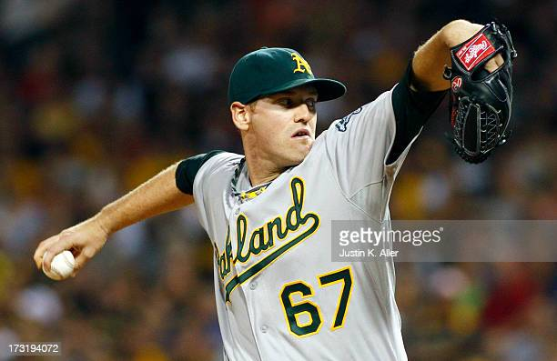 Dan Straily of the Oakland Athletics pitches in the first inning against the Pittsburgh Pirates during the game on July 9 2013 at PNC Park in...