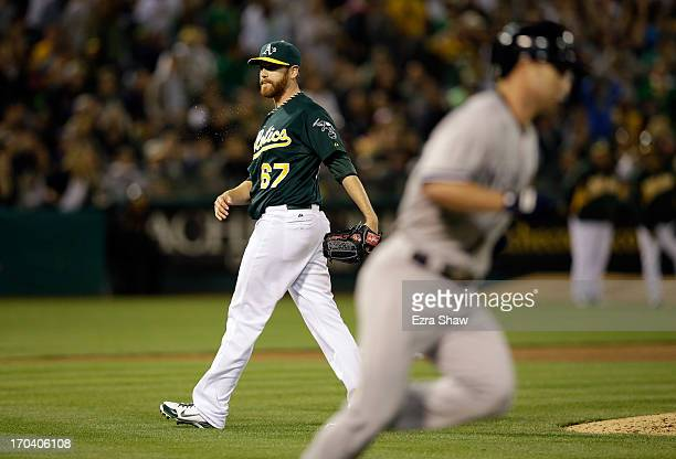 Dan Straily of the Oakland Athletics reacts after Jayson Nix of the New York Yankees hit a single that scored Kevin Youkilis in the seventh inning at...