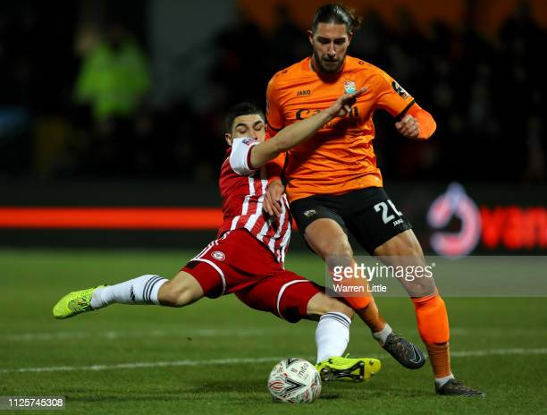 Dan Sweeney of Barnet is tackled by Neal Maupay of Brentford during the FA Cup Fourth Round match between Barnet and Brentford at The Hive on January...