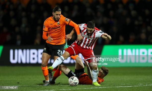 Dan Sweeney of Barnet is tackles Neal Maupay of Brentford during the FA Cup Fourth Round match between Barnet and Brentford at The Hive on January 28...