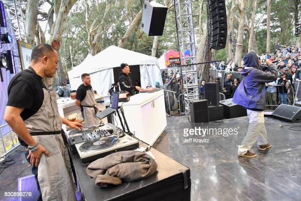 Dan the Automator and Roy Choi cook onstage while Del the Funky Homosapien performs during KIMCHI 3030 with Roy Dan and Del on the Gastro Magic stage...