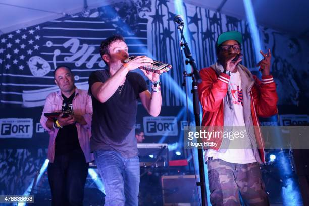 Dan the Automator Damon Albarn and Snoop Dogg perform onstage at The Fader Fort presented by Converse during SXSW on March 14 2014 in Austin Texas