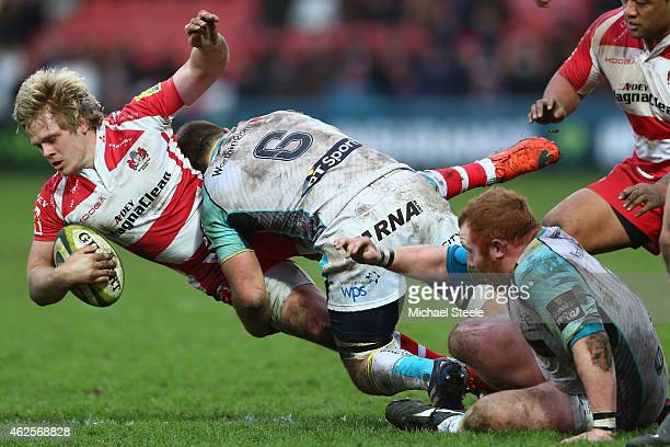 Dan Thomas of Gloucester is tackled by Olly Cracknell of Ospreys during the LV=Cup match between Gloucester Rugby and Ospreys at Kingsholm Stadium on...