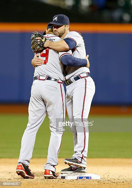 Dan Uggla and Andrelton Simmons of the Atlanta Braves celebrate the win over the New York Mets on April 18 2014 at Citi Field in the Flushing...