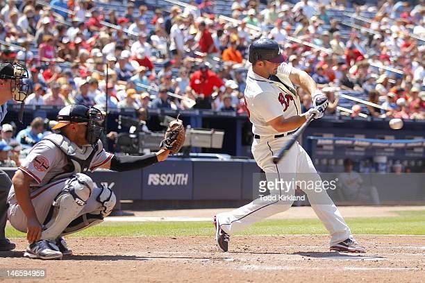 Dan Uggla of the Atlanta Braves bats during the interleague game against the Balitmore Orioles at Turner Field on June 17 2012 in Atlanta Georgia The...