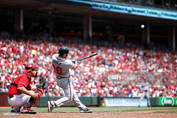 Dan Uggla of the Atlanta Braves hits his second home run of the game in the sixth inning against the Cincinnati Reds at Great American Ball Park on...