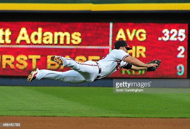 Dan Uggla of the Atlanta Braves makes a diving stop of a 4th inning ground ball against the St Louis Cardinals at Turner Field on May 6 2014 in...