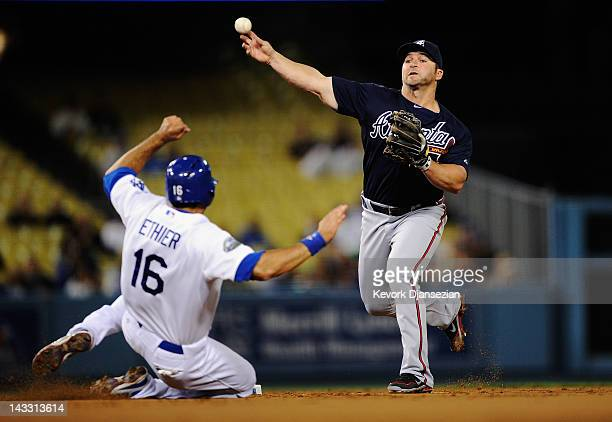 Dan Uggla of the Atlanta Braves throws to first base to complete a double play against Andre Ethier of the Los Angeles Dodgers during the first...