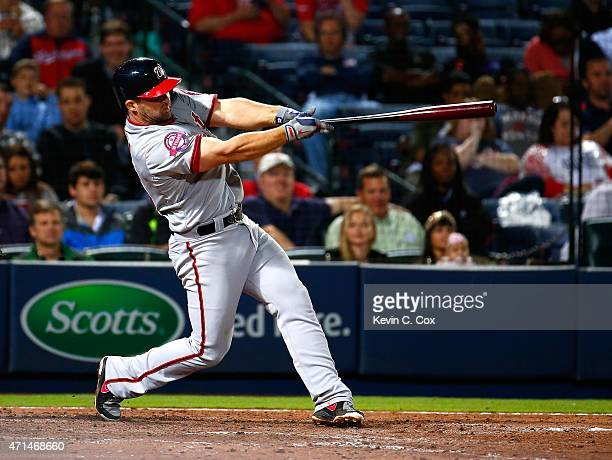 Dan Uggla of the Washington Nationals hits a 2RBI triple in the seventh inning against the Atlanta Braves at Turner Field on April 28 2015 in Atlanta...