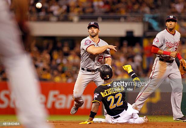 Dan Uggla of the Washington Nationals turns a double play in the seventh inning during the game against Andrew McCutchen of the Pittsburgh Pirates at...