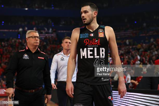Dan Vickerman, head coach of Melbourne United and Chris Goulding walk from the court during game one of the NBL Grand Final Series between the Perth...