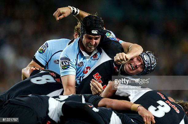 Dan Vickerman of the Waratahs controls a maul over Steven Sykes of the Sharks during the Super 14 semifinal match between the Waratahs and the Sharks...