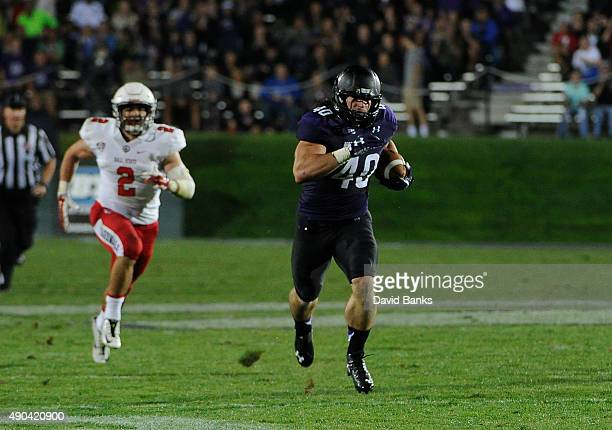 Dan Vitale fullback of the Northwestern Wildcats runs for a touchdown against the Ball State Cardinals during the first half on September 26, 2015 at...