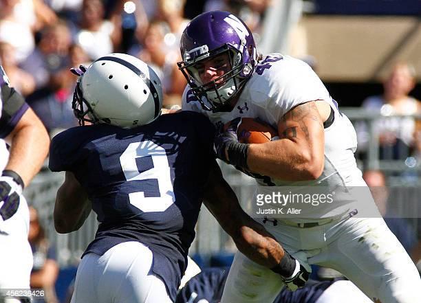 Dan Vitale of the Northwestern Wildcats rushes against Jordan Lucas of the Penn State Nittany Lions during the game against the Penn State Nittany...