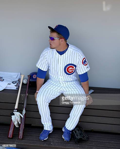 Dan Vogelbach of the Chicago Cubs watches action from the dugout during a spring training baseball game against the Cleveland Indians at Cubs Park on...