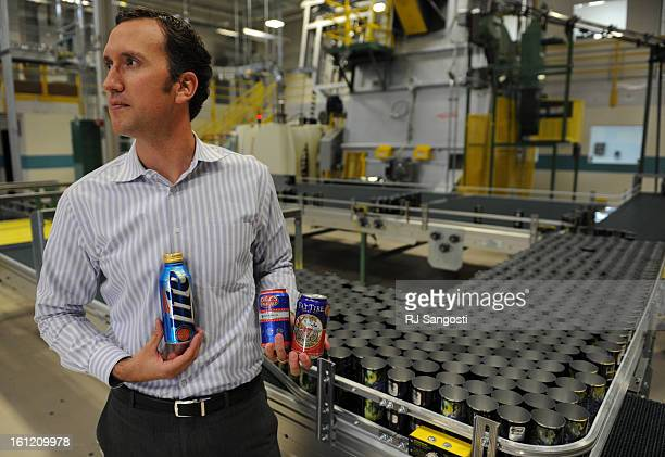 Dan Vorlage of Ball Corporation holds cans Tuesday Oct 11 at Ball Corporation in Westminster that are part of the new aluminum can look for the...