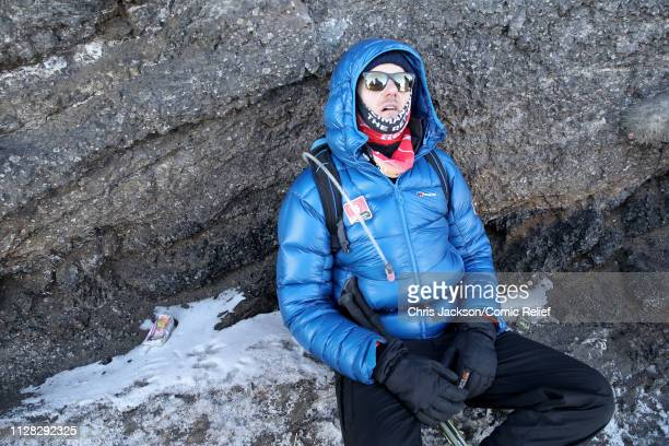 Dan Walker is seen at the top of Mount Kilimanjaro during day seven of 'Kilimanjaro The Return' for Red Nose Day on March 01 2019 in Arusha Tanzania...