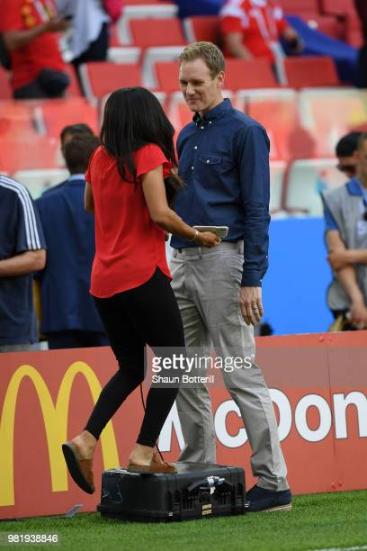 Dan Walker of the BBC speaks with former England and Arsenal player Alex Scott prior to the 2018 FIFA World Cup Russia group G match between Belgium...