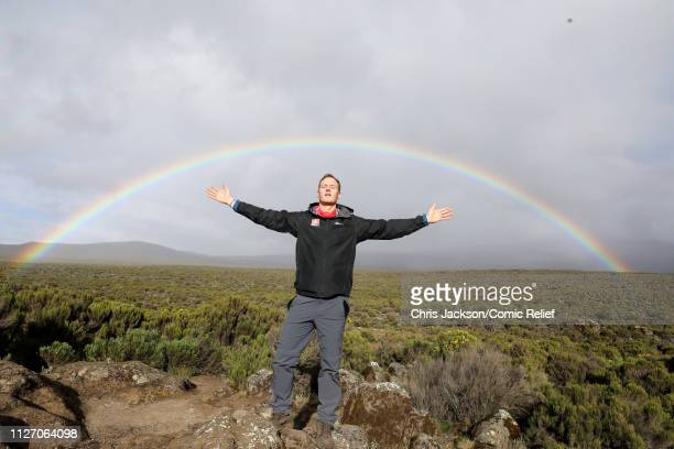 Dan Walker poses by a rainbow on day 2 of 'Kilimanjaro The Return' for Red Nose Day on February 24 2019 in Arusha Tanzania all to raise funds for...