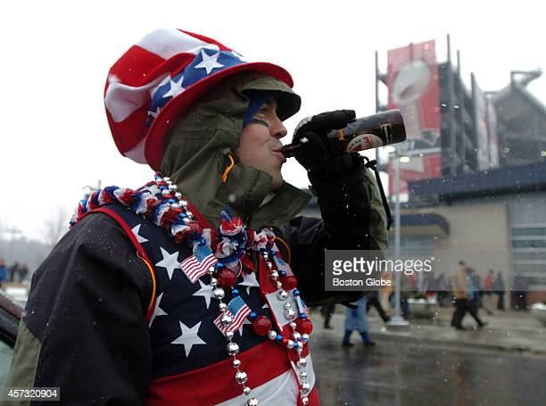 Dan Ward of Lexington Mass takes a slug of beer in front of Gillette Stadium prior to the start of the AFC Championship Game Ward bought his single...