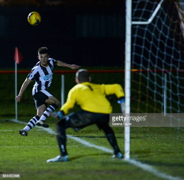 Dan Ward of Newcastle United head s the ball towards North Shields Goalkeeper Kyle Hayes during the Northumberland Senior Cup Semi Final between...