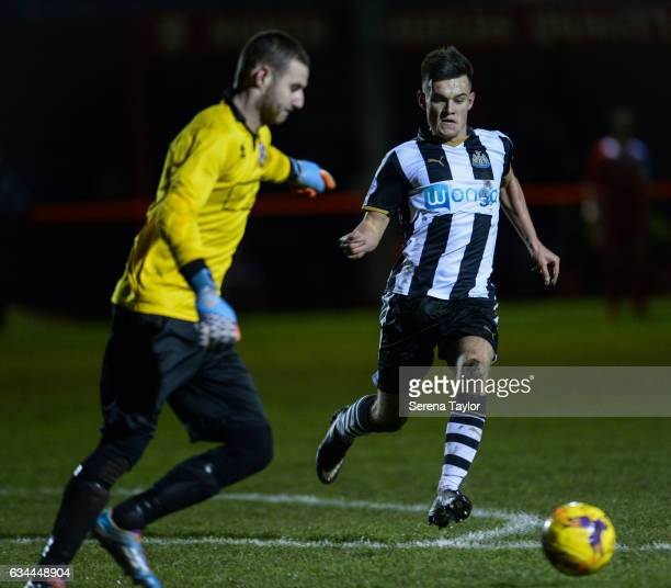 Dan Ward of Newcastle United looks to close down North Shields Goalkeeper Kyle Hayes during the Northumberland Senior Cup Semi Final between North...