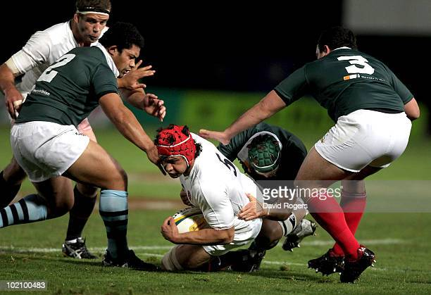 Dan WardSmith is brought down during the match between the Australian Barbarians and England at on June 15 2010 in Gosford Australia