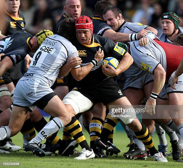 Dan WardSmith is held by Nic Berry during the Aviva Premiership match between London Wasps and Leicester Tigers at Adams Park on September 18 2010 in...