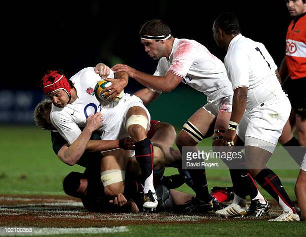 Dan WardSmith of England is tackled during the match between the Australian Barbarians and England at on June 15 2010 in Gosford Australia